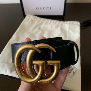 Woman's black leather Gold buckle Belt